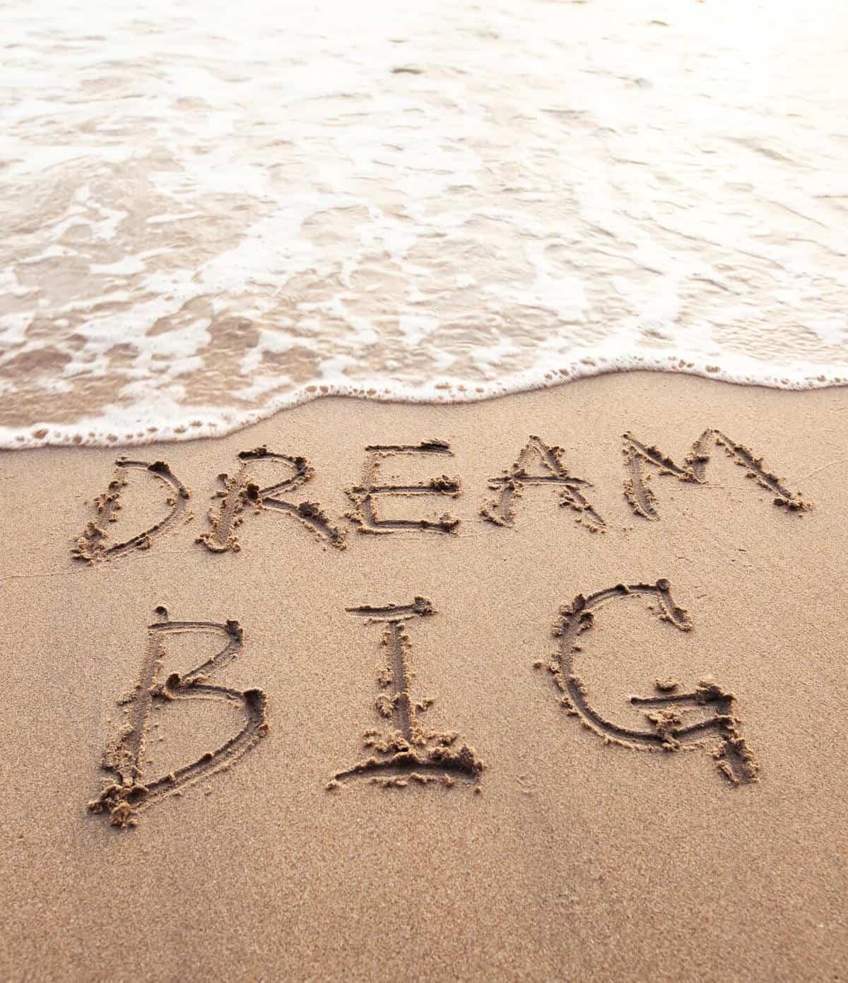 Dream Big written in sandy beach